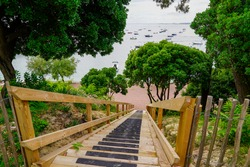 wooden stairs pedestrian access to sand of the beach and port in Le Canon cap ferret France