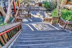 Wooden stairway and deck with pergola in scenic San Diego California outdoors