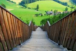 Wooden stairways with landscape in foreground.Styria,Austria