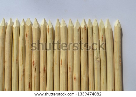 Wooden stakes on a white background. #1339474082