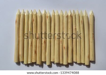 Wooden stakes on a white background. #1339474088