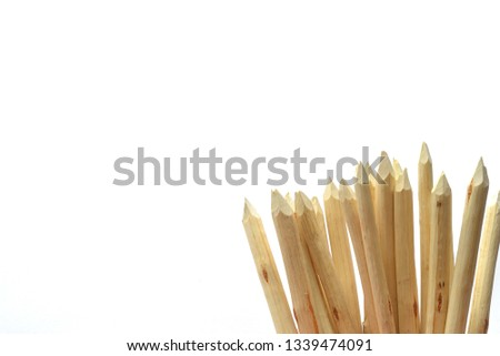 Wooden stakes on a white background. #1339474091