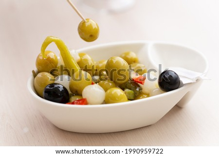 wooden stick prodding vegetarian or vegan snac made up of olives, chilli, chives, and pepper. healthy snac concept. Mediterranean diet. Spain Zdjęcia stock ©