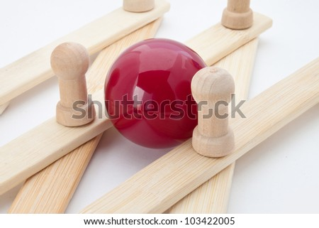 Wooden strips and a red ball.