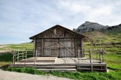 Wooden structure built in a clearing in the mountains