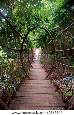 Wooden suspension bridge with cable arcs