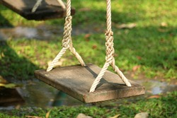 Wooden swing in playground