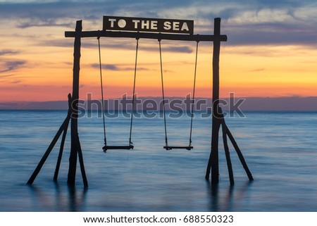 Wooden swing on the beach of Koh Kood island in Thailand.