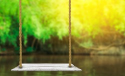 wooden swing with nature blurred background use for products or something display
