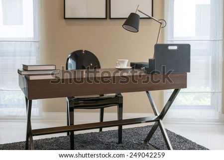 wooden table and books in modern working room interior #249042259