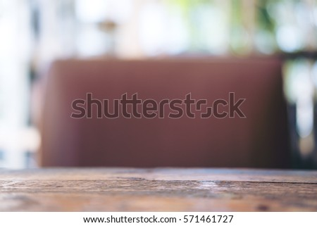 wooden table and brown leather...