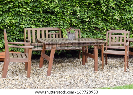 Wooden table and chair furniture in garden.