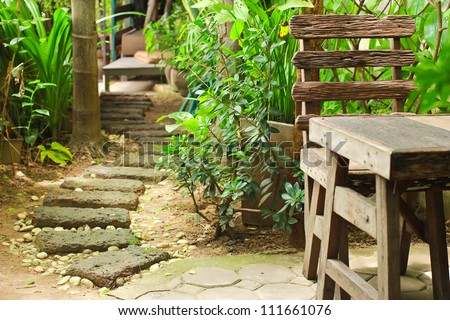 Wooden table and chair in garden