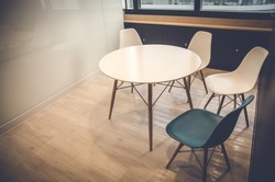 wooden table and chair in meeting room