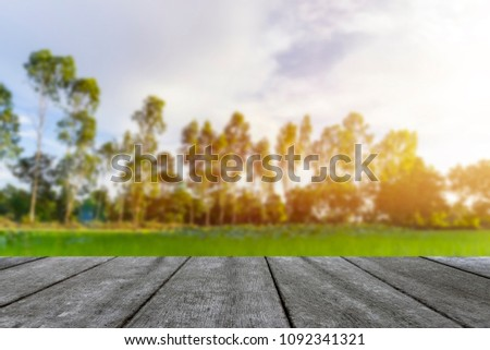 Wooden table blurred background of landscape with blue sky  #1092341321