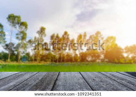 Wooden table blurred background of landscape with blue sky  #1092341351