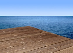 Wooden table corner with seascape background