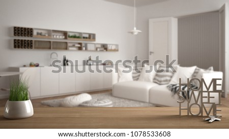 Wooden table, desk or shelf with potted grass plant, house keys and 3D letters making the words home sweet home, over modern white living room, interior design, copy space background, 3d illustration