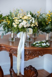 Wooden table filled with flowers