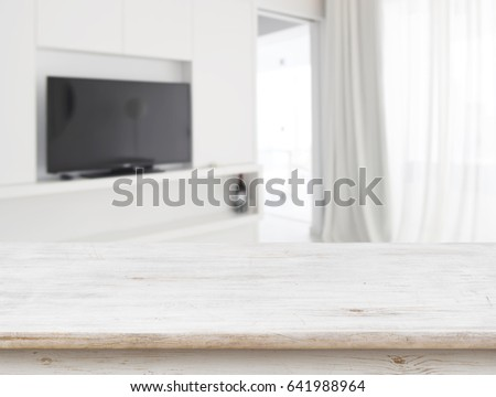 Wooden table in front of blurred living room interior background #641988964
