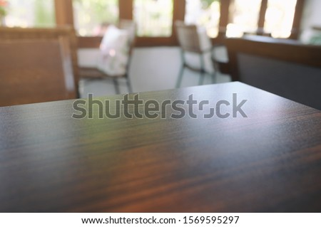 Wooden table in the cafe, Blurred background, Perspective View. #1569595297