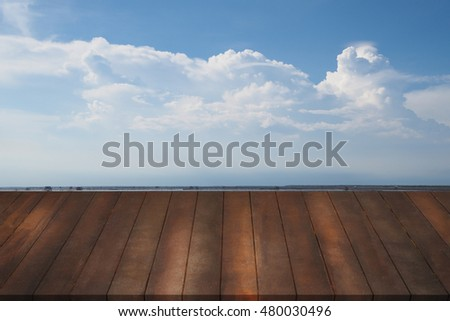 Wooden table, mock up outdoor with cloudy sky background, empty