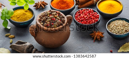 Wooden table of colorful spices. Top view