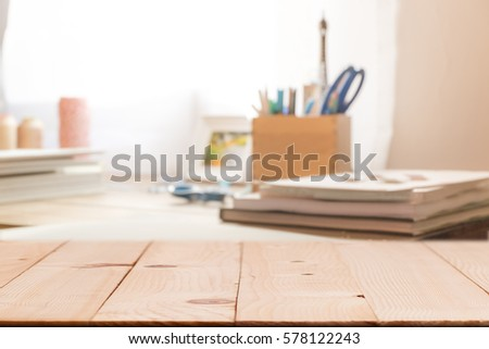 Wooden table on defocused curtain window and stationery box with sunlight .For montage product display or design key visual layout
