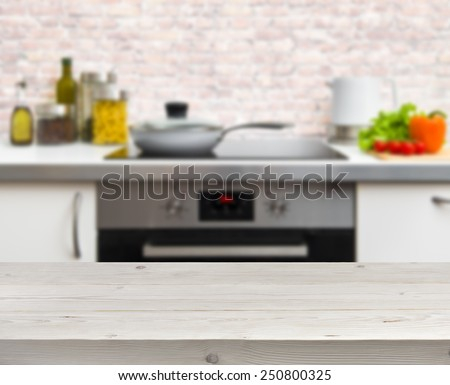 Wooden table on defocused rustic kitchen background