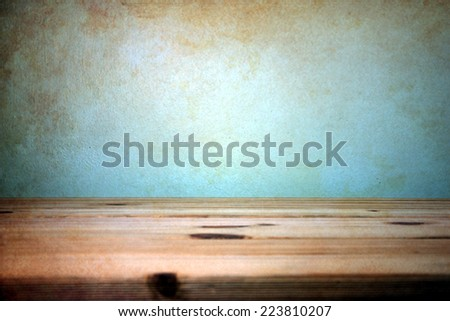 wooden table over wall grunge...