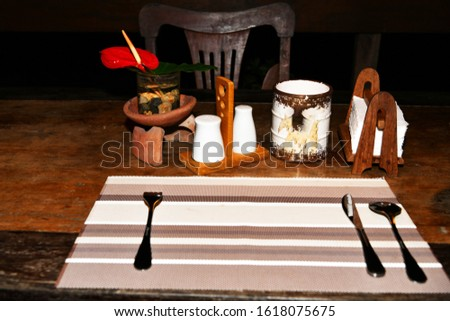 wooden table served for one person