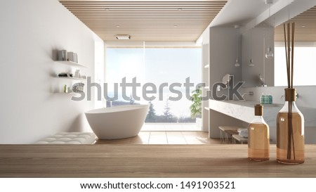 Wooden table top or shelf with aromatic sticks bottles over blurred modern minimalist luxury bathroom with bathtub and panoramic window, white architecture interior design, 3d illustration