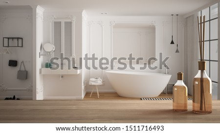 Wooden table top or shelf with aromatic sticks bottles over blurred modern minimalist luxury bathroom with bathtub, sink and decors, white architecture interior design, 3d illustration