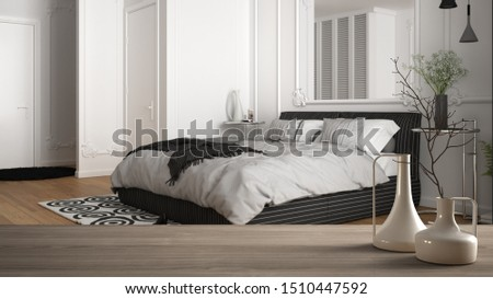 Wooden table top or shelf with minimalistic modern vases over blurred classic luxury bedroom with bed, pillows, blankets and parquet floor, minimalist architecture interior design, 3d illustration