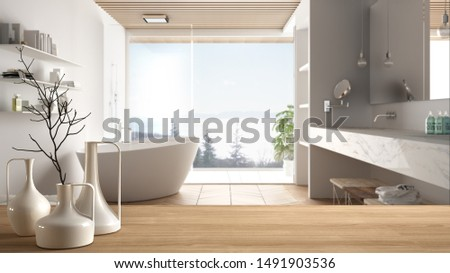 Wooden table top or shelf with minimalistic modern vases over blurred minimal luxuty bathroom with panoramic window, shower and bathtub, minimalist architecture interior design, 3d illustration