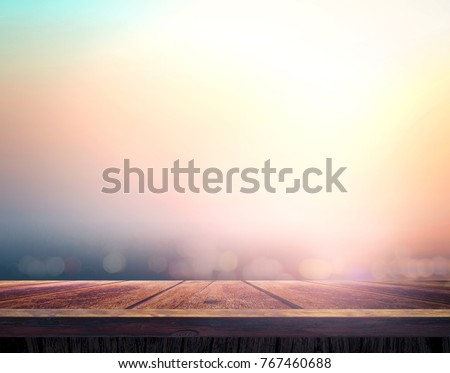 wooden table with blurred...