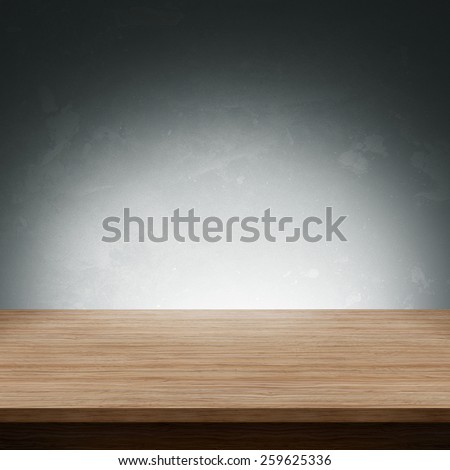 Wooden table with dark background