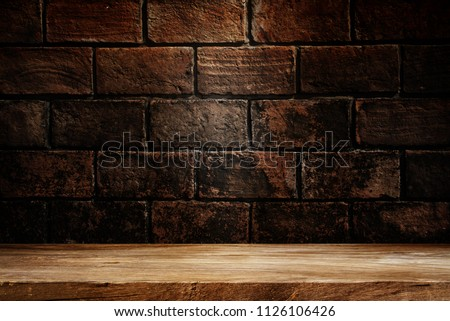 Wooden table with dark background concept for advertising.