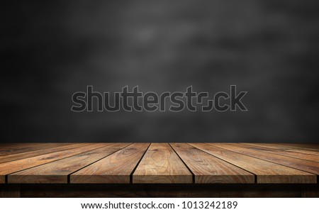 Wooden table with dark blurred background. #1013242189