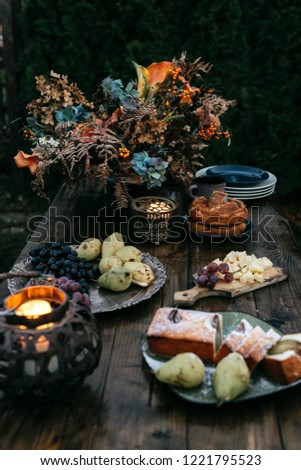 Wooden table with delicious food, rustic atmosphere, dark atmosphere #1221795523