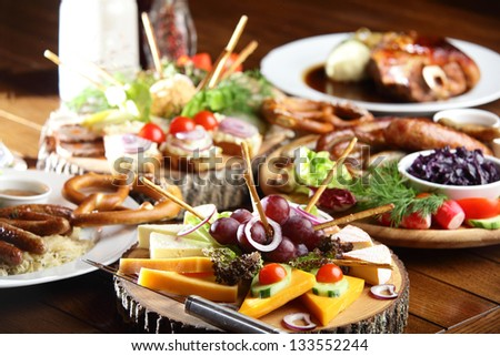 wooden table with different cuts and fruits with vegetables