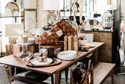 wooden table with modern home goods, unique home decoration store