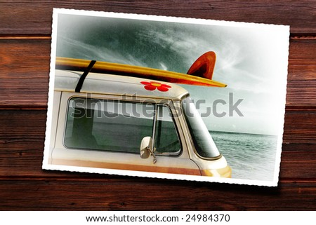 Wooden table with old photographic print of a van with a surfboard
