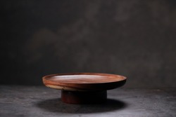 Wooden Tableware,flat wooden tableware placed on grey textured background.