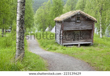 Wooden tepee, warehouse building in the Nordic taiga mountains. Elderly wooden buildings in a landmark, memorial in the Nordic mountain and countryside .