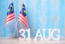 Wooden text of August 31 with Malaysia flags. Malaysia Independence day