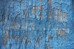 wooden texture blue fence with cracked paint
