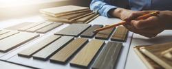 wooden texture furniture material samples for interior design. designer working in office. banner