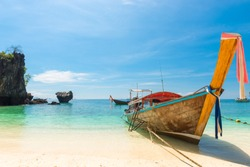 wooden Thai boat in the Andaman Sea off the coast of the island