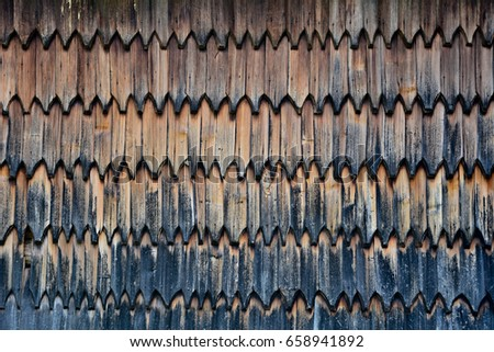 Wooden tiles texture. Tiles background. Tiles pattern. Roof tiles #658941892